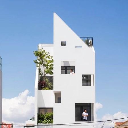 """Căn nhà gây ấn tượng bởi lối kiến trúc lệch tầng độc đáo, giúp chủ nhân """"nới rộng"""" không gian"""