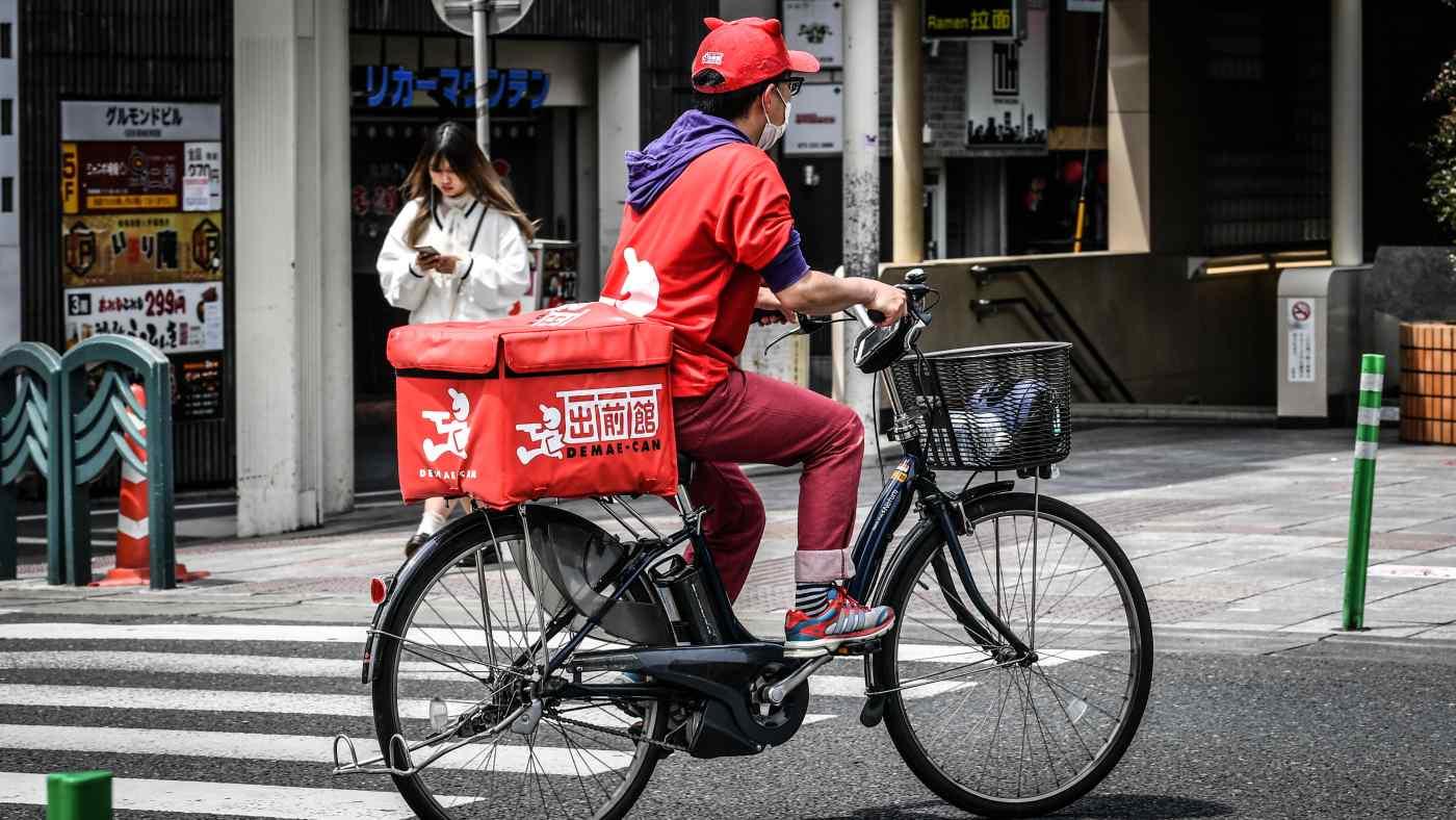 Các chuyên gia nhận định tốc độ giao hàng chậm là nguyên nhân chính khiến Demaecan đánh mất vị thế vào tay Uber. Ảnh:Toshiki Sasazu