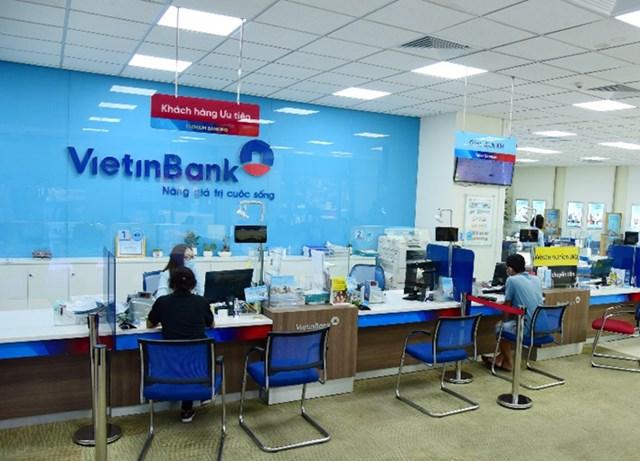 VietinBank tiếp tục giảm lãi và phí với quy mô trên 2.000 tỷ để hỗ trợ doanh nghiệp và người dân - Ảnh 1