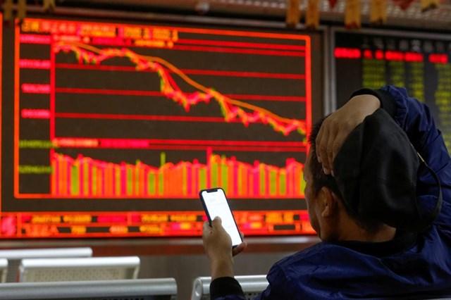 Làn sóng vỡ nợ của các công ty thuộc sở hữu nhà nước khiến thị trường trái phiếu Trung Quốc chao đảo. Ảnh:Reuters.