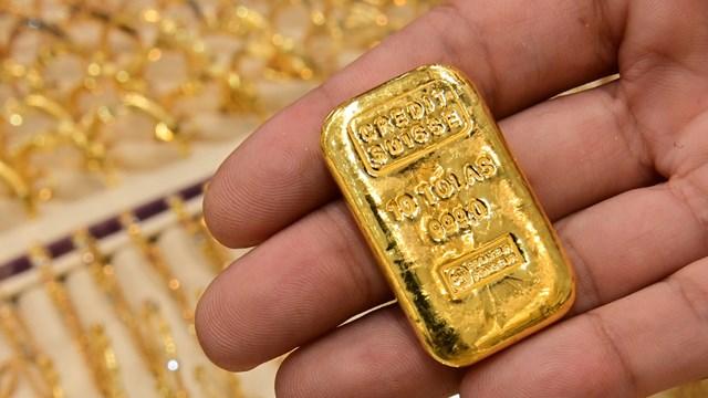 Đà giảm của vàng khá mạnh khi đồng bạc xanh và lợi suất trái phiếu Mỹ tăng và dữ liệu kinh tế tốt.