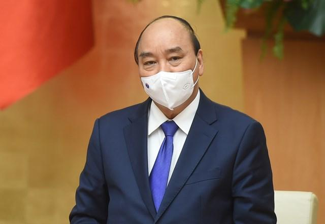 Thủ tướng Nguyễn Xuân Phúc yêu cầuphải có vaccine Covid-19 trong tháng 2.