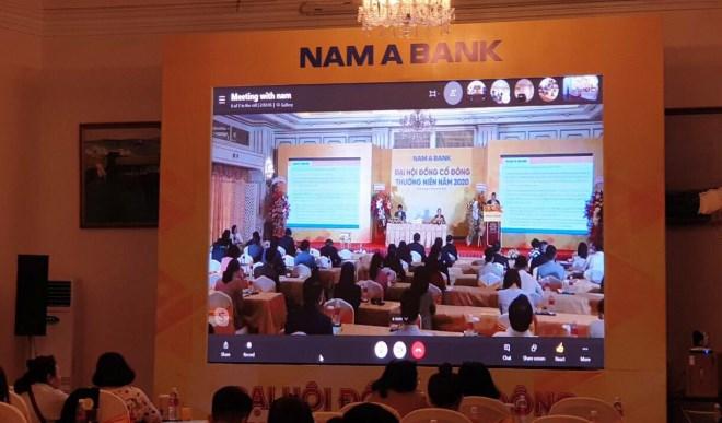 ĐHCĐ đặc biệt của Nam Á Bank: Chủ tịch không xuất hiện, cổ đông bị chia phòng, tài liệu có dấu hiệu bất thường - Ảnh 1